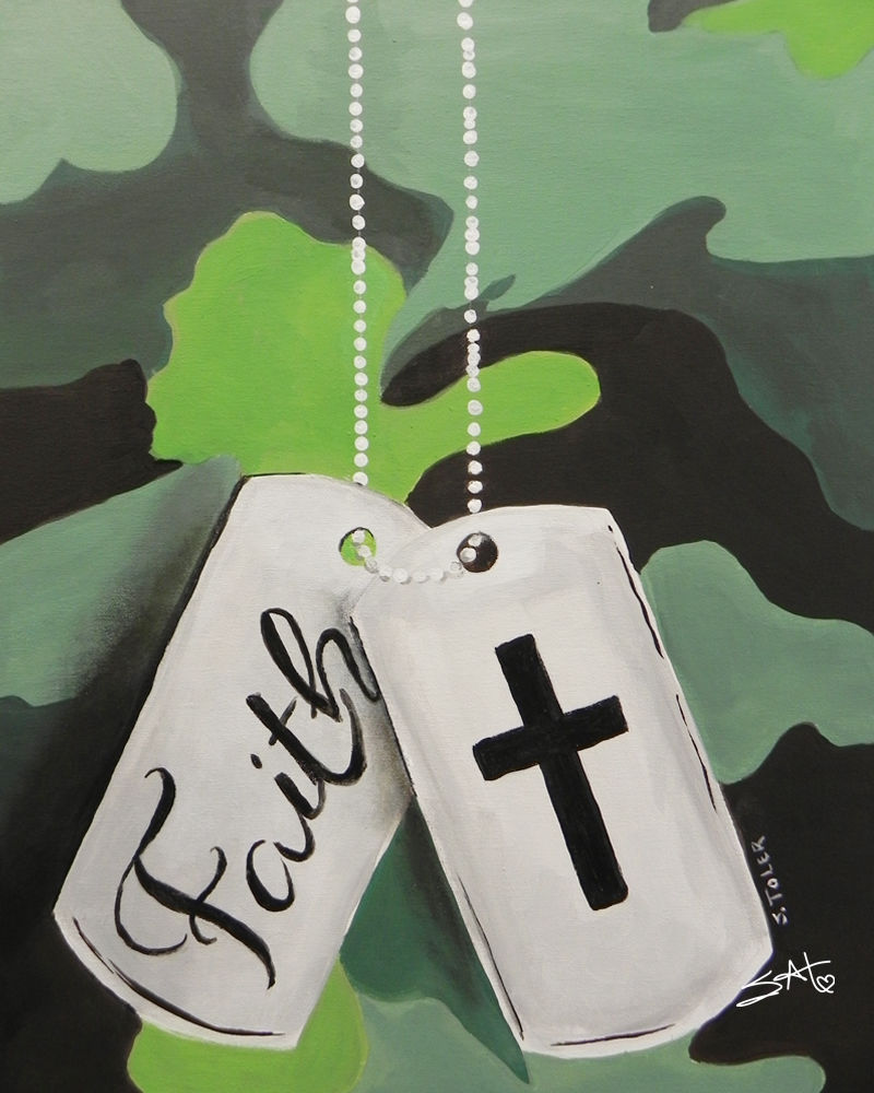 tags with the word faith and a cross image drapped across green camouflage