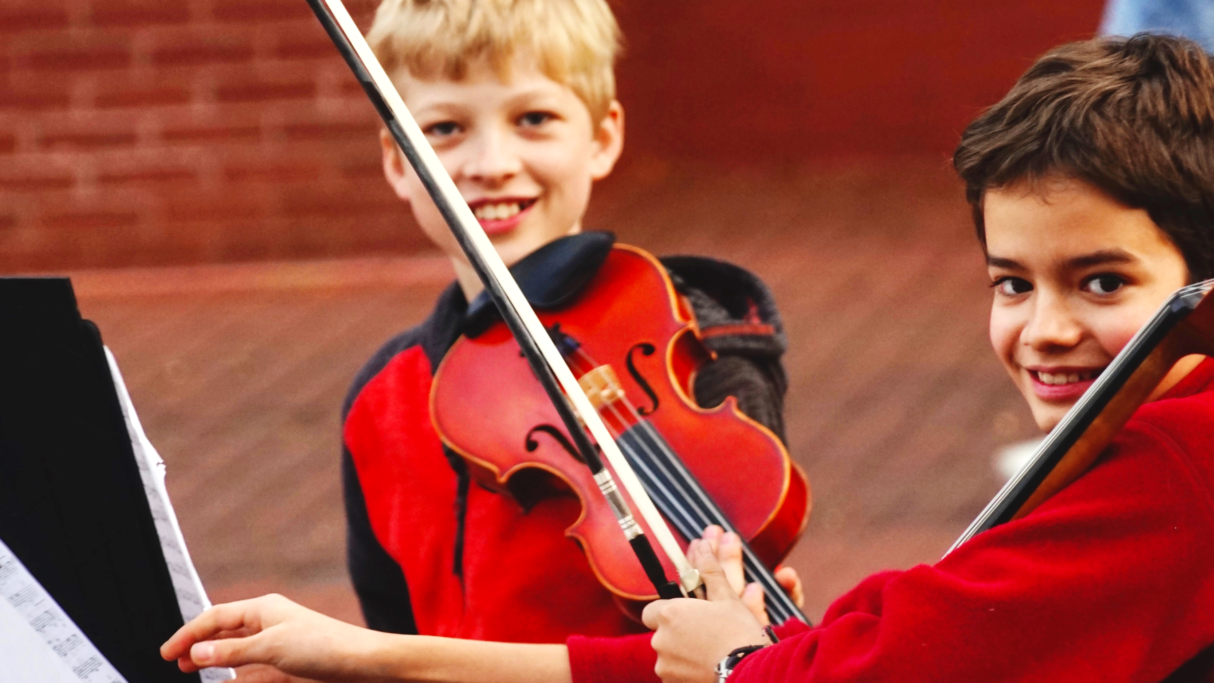 students learn orchestra violin