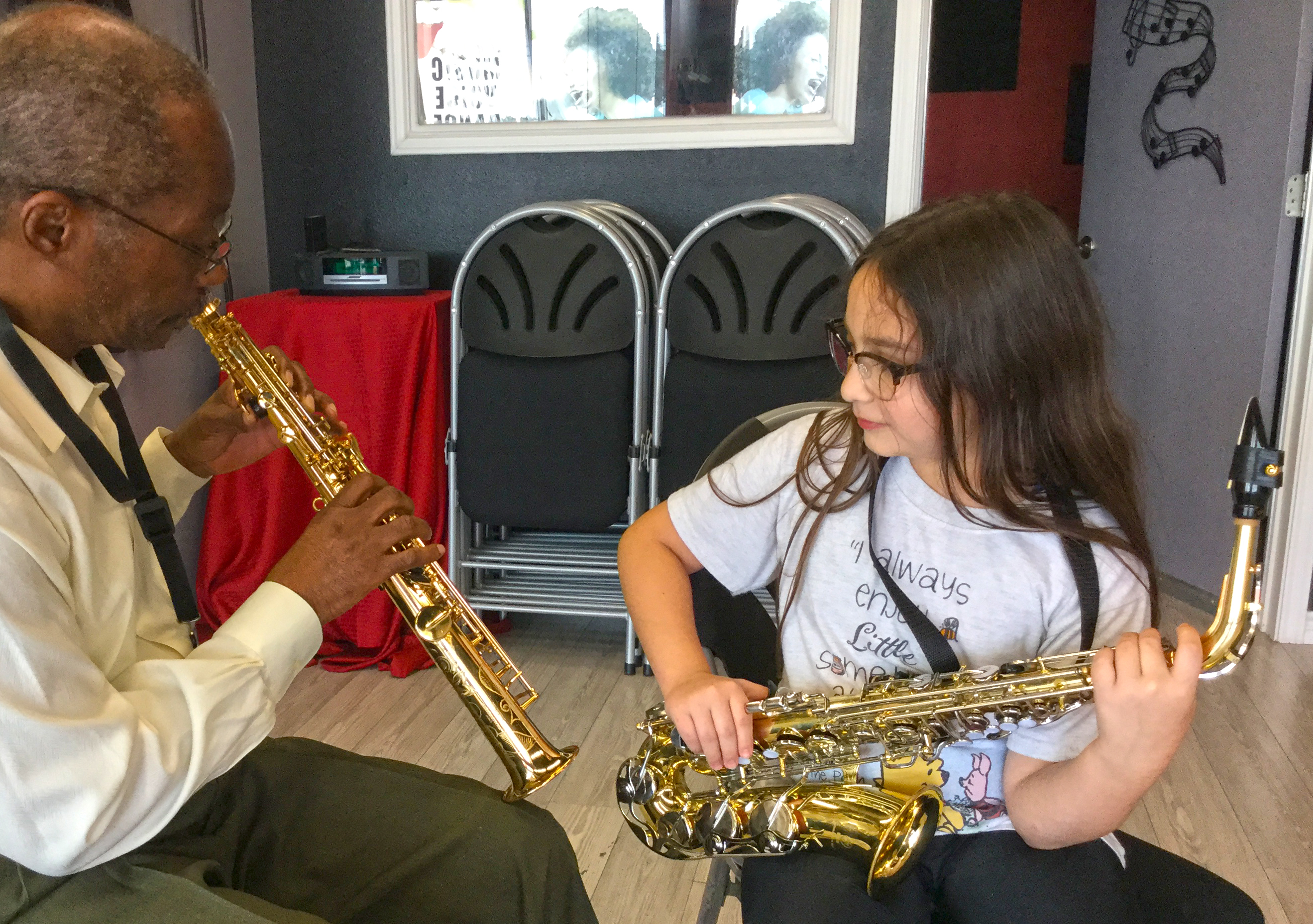 student learning to play saxophone